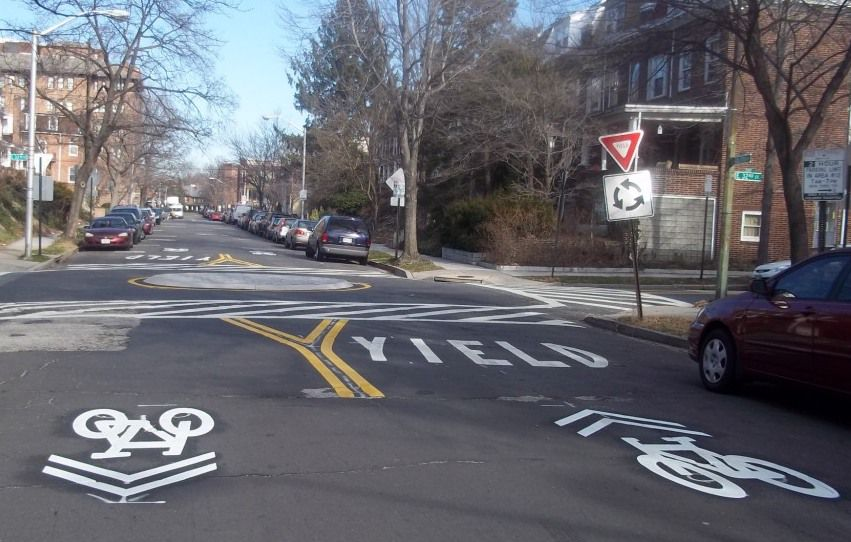 Mini Traffic Circle - Baltimore, MDThis intersection conversion on the Guilford Avenue Bicycle Boulevard  uses a mini traffic circle configuration to reduce speeds and user conflict.