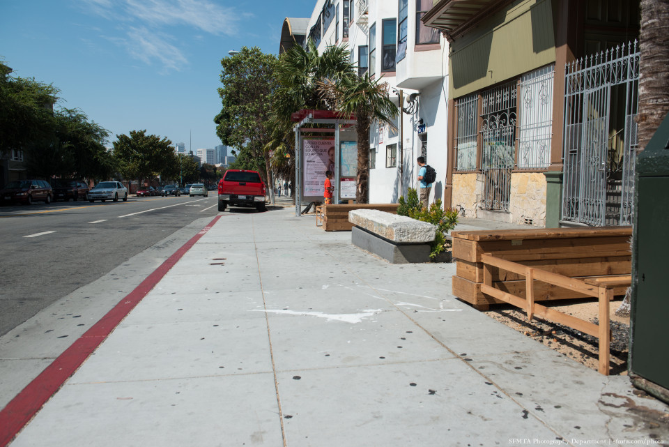 Shelter on boarding bulb with landscaping features, San Francisco (credit: SFMTA)
