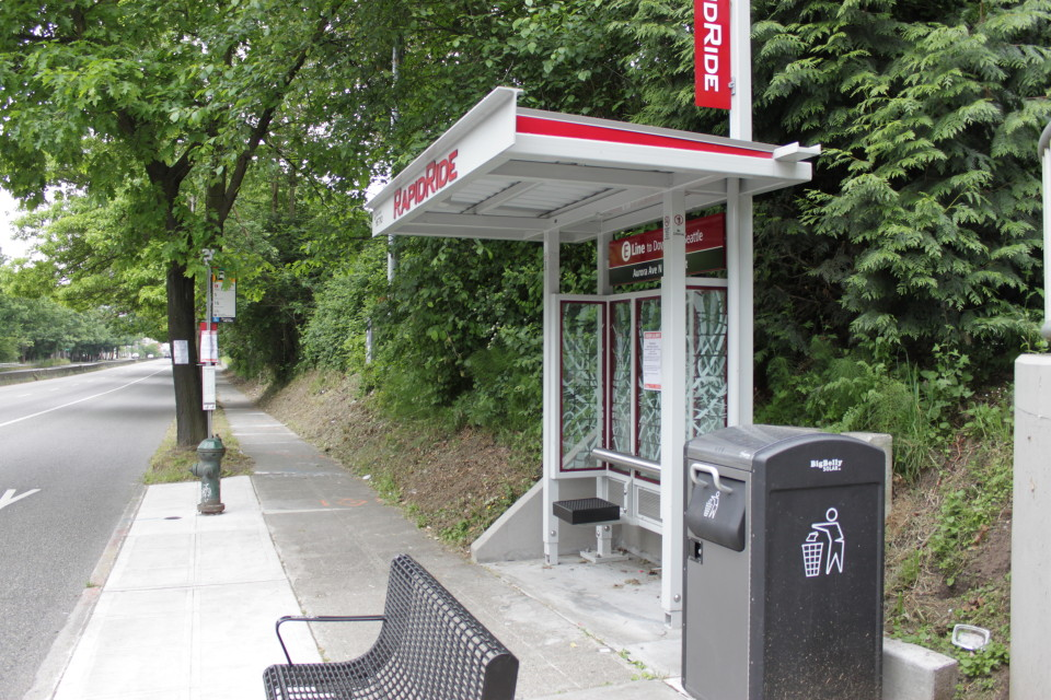 Branded rapid service shelter on constrained sidewalk, Seattle (credit: Flickr user SounderBruce