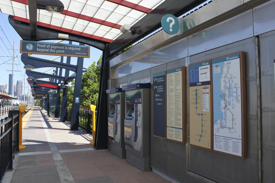 Transit station with Proof-of-Payment board and fare validators, Seattle (credit: SounderBruce)