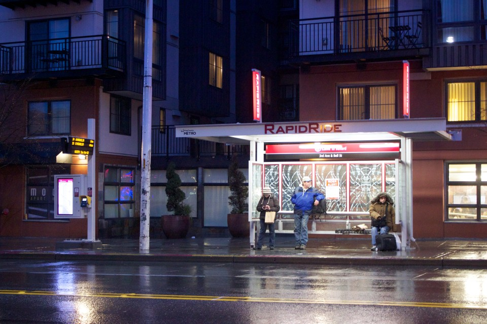 Branded rapid service bus shelter with bench and leaning rail, Seattle (credit: Oran Viriyincy)