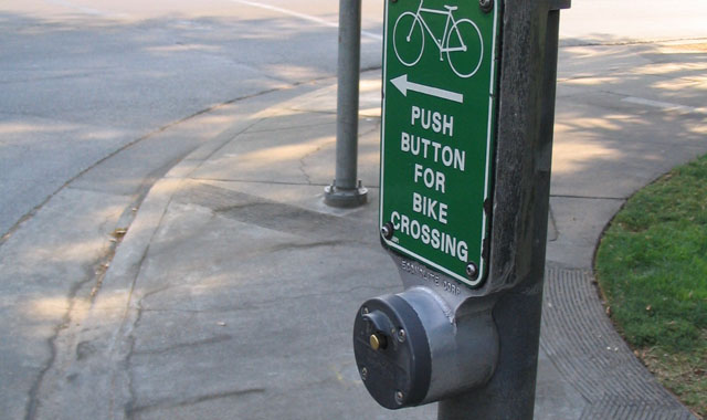 Bike Signal - Davis, CAPush button actuation of bicycle signals should be easily accessible by bicyclists.Photo: Dave Roth