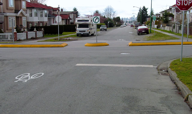 Median Refuge Island - Vancouver, BCThis median refuge island and traffic diverter provides a space for crossing bicyclists to wait for gaps in traffic.