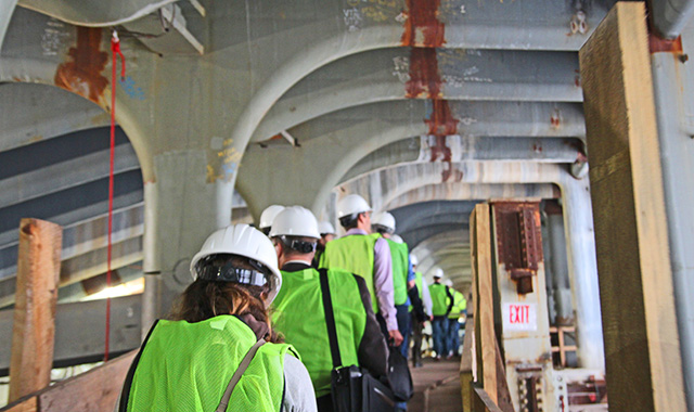 Transportation officials visit the transportation hub under construction at the World Trade Center.