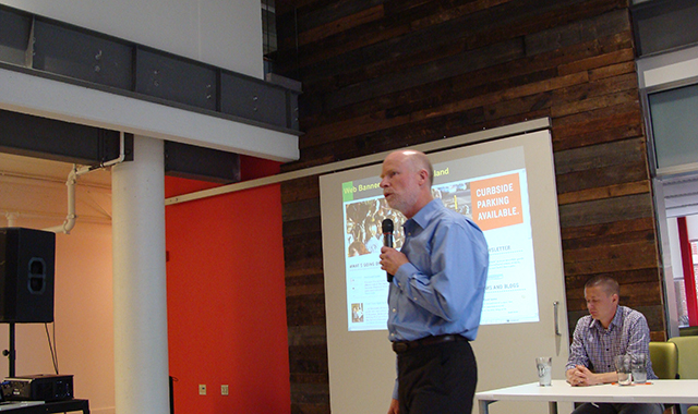 Portland City Traffic Engineer Rob Burchfield presents to a crowd of city and community leaders.