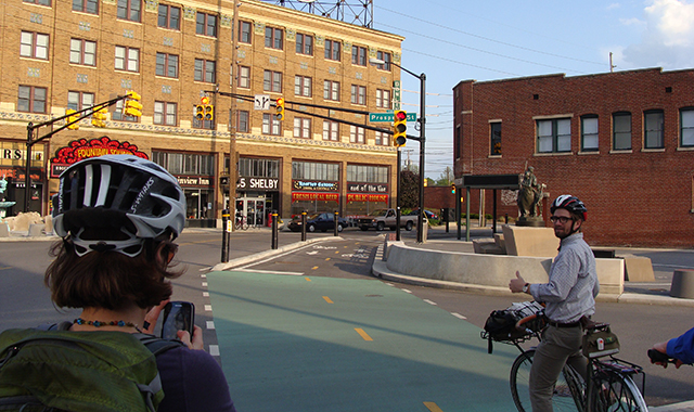 Jamison Hutchins, Indianapolis Bicycle-Pedestrian Coordinator, explains a new cycle track design at Fountain Square.