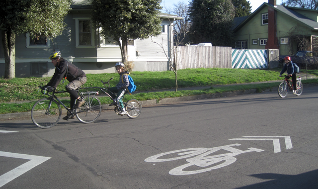 Shared Lane Marking – Portland, ORShared lane markings identify the Going Street Neighborhood Greenway as a bicycle priority route.