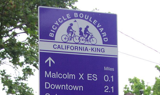 Decision Sign - Berkeley, CABerkeley\'s bicycle boulevard wayfinding signs provide directional guidance and distances to key destinations.