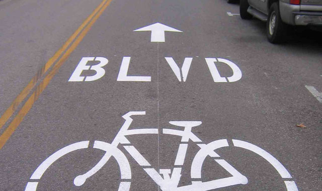 Shared Lane Marking - Berkeley, CABerkeley uses large pavement stencils with BLVD text to indicate that people on bicycles have priority.