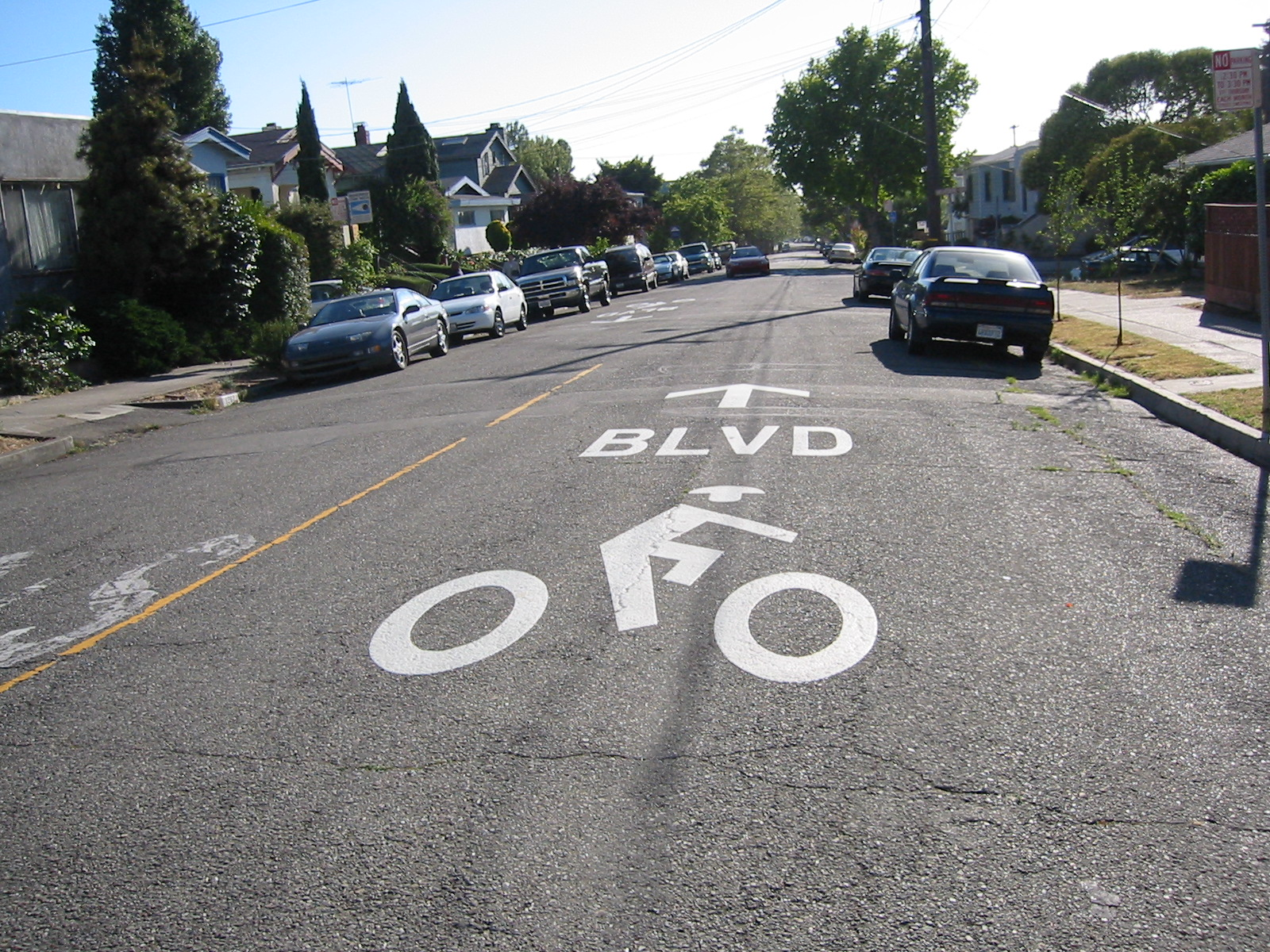 Bicycle Boulevard Pavement Marking - Berkeley, CABerkeley uses large pavement stencils with BLVD text to indicate that people on bicycles have priority.