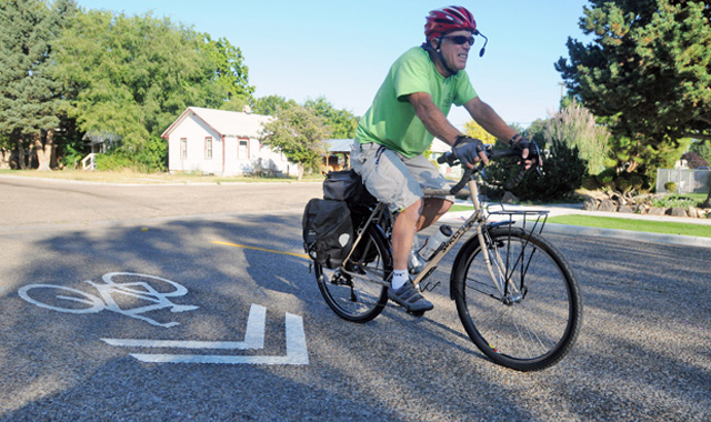 Shared Lane Marking - Nampa, IDShared lane markings communicate that bicyclists may ride in the center of a lane.Photo: Charlie Litchfield, Idaho Press Tribune