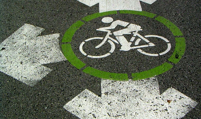 Wayfinding Pavement Marking - Vancouver, BCDirectional pavement markings may indicate the intersection of multiple bikeways.