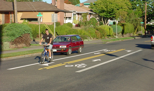 Center Left Turn Lane – Portland, ORA pair of center running left turn lanes on the 40s Bikeway allow bicyclists to cross an offset intersection in two-stages and provide refuge outside of the travel lanes.