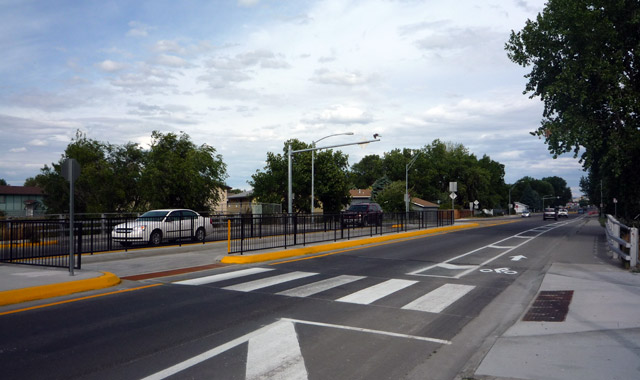 Center Median Offset Trail Crossing - Billings, MTA median refuge island protects a left-turn lane designed to simplify an offset trail crossing.