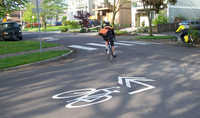 Directional Shared Lane Marking - Portland, ORA modified shared lane marking directs people on bikes to the next link in a bicycle boulevard.