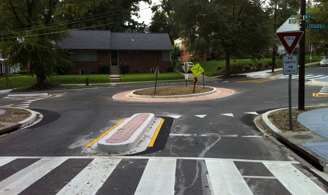 Mini Traffic Circle – Washington, DC A mini traffic circle at 14th St. NW & Leegate Rd NW slows vehicles and clarifies movements at an skewed intersection.