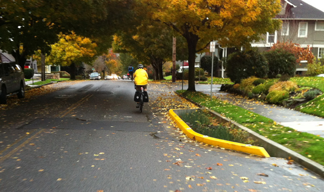 Curb Extension - Portland, ORA curb extension featuring an integrated bioswale calms traffic on this Portland bicycle boulevard.