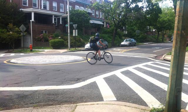 Mini Traffic Circle - Baltimore, MDMini traffic circles use horizontal deflection to slow motor vehicle speeds at intersections. Photo: Patrick McMahon
