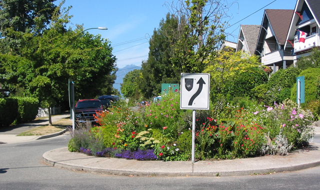 Mini Traffic Circle - Vancouver, BCIn Vancouver, neighborhood groups maintain gardens in mini traffic circles, which can be attractive street features that slow motor vehicles.