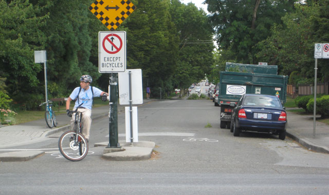 Partial Diverter - Vancouver, BCAt this diverter bicyclists are provided a protected place to wait and actuate a crossing signal.
